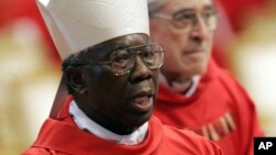 Nigerian Cardinal Francis Arinze attends a Mass in St. Peter's Basilica at the Vatican, April 18, 2005.