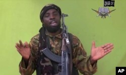 FILE - This photo taken from video by Nigeria's Boko Haram terrorist network, shows their leader Abubakar Shekau speaking to the camera.