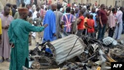 People look at the damages after two explosions rocked a crowded neighborhood of Nigeria's restless northeastern city of Maiduguri, a stronghold of Boko Haram, on March 2, 2014.
