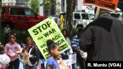 Protesters gather before a march and rally in Baltimore, May 2, 2015.