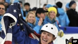 In this Feb. 25, 2010 file photo, Jeret Peterson of the United States, celebrates his Olympic silver medal in the men's freestyle aerials final at the Vancouver 2010 Olympics.