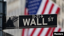 The Wall Street sign is pictured at the New York Stock exchange (NYSE) in the Manhattan borough of New York City, New York, U.S., March 9, 2020.
