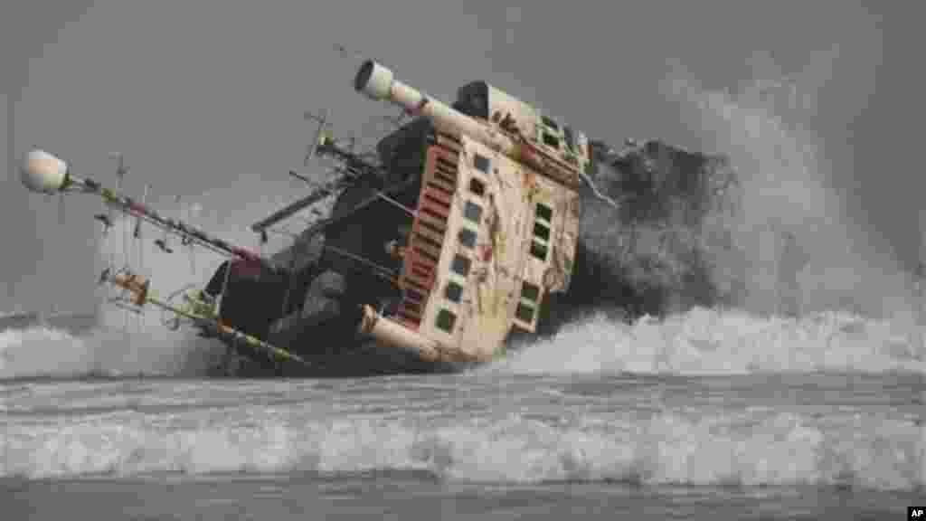 An abandoned ship is beached on the coastline in Nigeria.