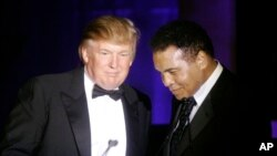"FILE - Donald Trump accepts his Muhammad Ali award from Ali at the boxing legend's ""Celebrity Fight Night XIII"" in Phoenix, Ariz., March 24, 2007."