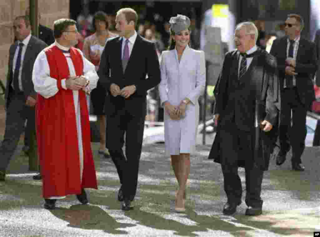 Britain's Prince William, second from left, and his wife, Kate, Duchess of Cambridge, second from right, walk with The Most Reverend Glenn Davies, Archbishop of Sydney, left, and The Very Reverend Phillip Jensen, Dean of Sydney, as they arrive at St. Andr