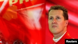 FILE - Ferrari Formula One driver Michale Schumacher watches a monitor during a free practice session for the Belgian Grand Prix in Spa-Francorchamps race circuit, Aug. 27, 2004.