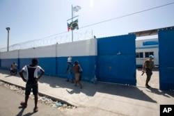 FILE - A Brazilian U.N. peacekeeper opens a gate at the U.N. base in the Cite Soleil slum of Port-au-Prince, Haiti.