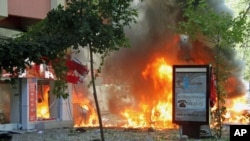 Flames are seen in a street after a blast killed several people and injured others, in central Ankara, Turkey, September 20, 2011.