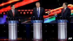 During a Republican presidential candidates' debate, businessman Donald Trump, center, reacts to Texas Sen. Ted Cruz, right, as Florida Sen. Marco Rubio looks on, in Houston, Texas, Feb. 25, 2016.