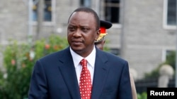 FILE - Kenya's President Uhuru Kenyatta at the National Assembly Chamber in Nairobi, April 16, 2013.