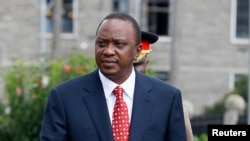 Kenya's President Uhuru Kenyatta prepares to inspect a guard of honor in Nairobi, April 16, 2013.