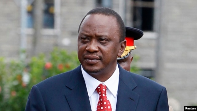 FILE - Kenya's President Uhuru Kenyatta prepares to inspect a guard of honor before the opening of the 11th Parliament at the National Assembly Chamber in Nairobi, April 16, 2013.