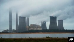 FILE - The coal-fired Plant Scherer is shown in operation June 1, 2014, in Juliette, Ga. A survey across 40 countries around the world found most people see global warming as a serious problem.