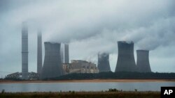 FILE - A coal-fired power plant is shown spewing fumes in Juliette, in the southeastern U.S. state of Georgia.