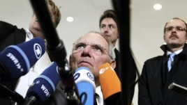 German Finance Minister Wolfgang Schaeuble speaks with the media prior to a meeting of eurozone finance ministers in Luxembourg, June 21, 2012 (AP).