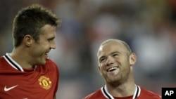 Wayne Rooney (dama) da Michael Carrick na kungiyar Manchester United