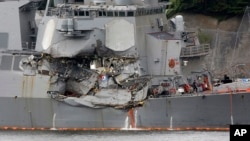 Damaged part of USS Fitzgerald is seen at the U.S. Naval base in Yokosuka, southwest of Tokyo, June 18, 2017.