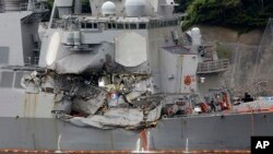Damaged part of USS Fitzgerald is seen at the U.S. Naval base in Yokosuka, southwest of Tokyo, June 18, 2017. Navy divers found a number of sailors' bodies Sunday aboard the stricken USS Fitzgerald that collided with a container ship in the busy sea off