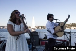 The Local Strangers Perform on a Boat. Photo by George Bentley