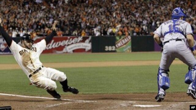 San Francisco Giants' Cody Ross slides safely home in front of Texas Rangers' Matt Treanor during the seventh inning of Game 2 of baseball's World Series Thursday, Oct. 28, 2010, in San Francisco.