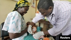 A baby receives an injection in a malaria vaccine trial in the Kenya coastal town of Kilifi.