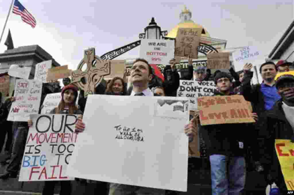 Jason Potteiger, center, leads demonstrators in a chant in front of the Statehouse, in Boston, as part of an Occupy Boston demonstration on Monday, Oct. 3, 2011. The group is part of a nationwide grassroots movement in support of the ongoing Wall Street p