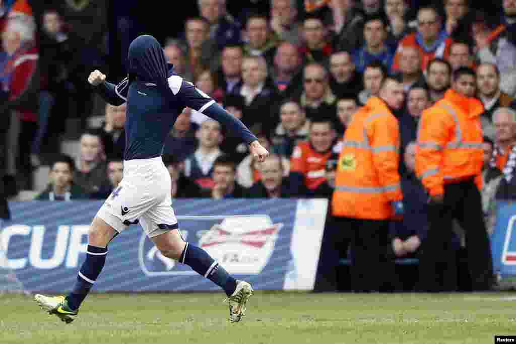 Millwall's James Henry celebrates after scoring against Luton Town during their FA Cup fifth round soccer match at Kenilworth Road in Luton, central England.