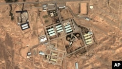 FILE - Satellite image provided by DigitalGlobe and the Institute for Science and International Security shows the military complex at Parchin, Iran, 30 kilometers (about 19 miles) southeast of Tehran.