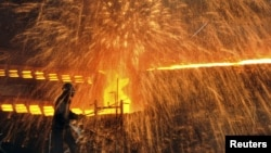 A Chinese laborer works at a steel factory in Dalian, Liaoning province, December 4, 2012.