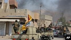 Les forces armées irakiennes en patrouille à Tuz Khormato, le 16 octobre 2017.