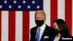 Democratic presidential candidate Joe Biden and vice presidential candidate Senator Kamala Harris take the stage at a campaign event, their first joint appearance, in Wilmington, Delaware, August 12, 2020. (REUTERS/Carlos Barria)