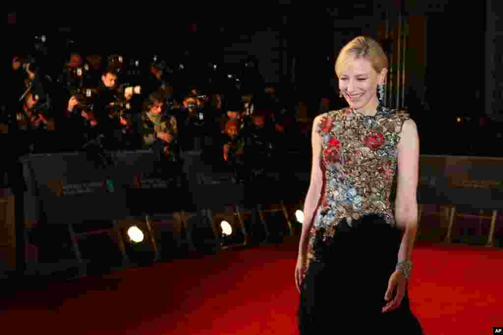 Actress Cate Blanchett poses for photographers upon arrival at the BAFTA 2016 film awards at the Royal Opera House in London.