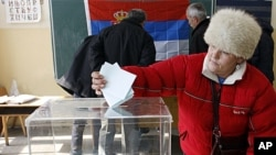 A woman casts her ballot at the polling station in Zvecan, Kosovo, February 14, 2012.