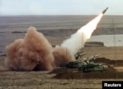 FILE - A Buk anti-aircraft battery launches a ground-to-air missile during the Ukrainian army's military maneuvers at the Chauda firing ground in the Crimean peninsula, Oct. 12, 1999.