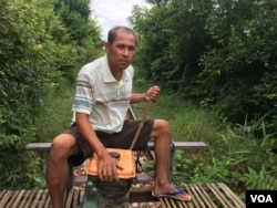 Pheach Tum, 52, has been a bamboo train driver for almost 20 years. His wife is a food vendor at the train station. Their income depends heavily on this tourism site. (Sun Narin/VOA Khmer)