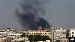 Black columns of smoke rise from heavy shelling in the Jobar neighborhood, east of Damascus, Syria, Sunday, Aug. 25, 2013. Syria reached an agreement with the United Nations on Sunday to allow a U.N. team of experts to visit the site of alleged chemical w