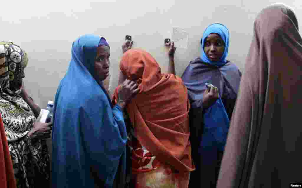 Leyla Ali Adow (C), a suspected Somali illegal migrant arrested in a police swoop, reacts after being processed for deportation at a holding station in Kenya's capital Nairobi.