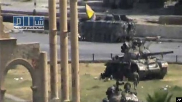 In this image made from amateur video released by the so-called Shams News Network, a loosely organized anti-Assad group and accessed via The Associated Press Television News on Aug. 1, 2011, military armored vehicles are seen in the central city of Hama,