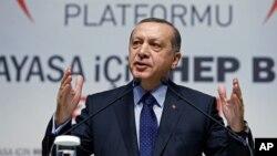 Turkey's President Recep Tayyip Erdogan addresses his supporters in Ankara, Jan. 28, 2016.