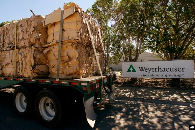FILE - A truck loaded with recycled cardboard arrives at The Weyerhaeuser Co. Hueneme Paper Mill plant in Oxnard, California, March 17, 2008.