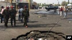 Bom mobil meledak di Baghdad Baru, Selasa, 26 Agustus 2014.