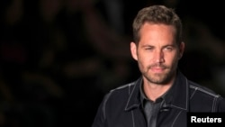 FILE - Paul Walker, March 21,2013.