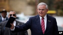 FILE - U.S. Sen. Bob Menendez waves at reporters before entering the federal courthouse in Newark, N.J., for his corruption trial, Nov. 16, 2017. The trial ended in a deadlocked jury; it was announced Jan. 31, 2018, that the government had dropped its case against the senator.