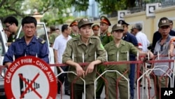 Vietnamese security officers set up a fence outside the Chinese Embassy, Hanoi, May 18, 2014.