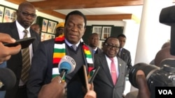 FILE: resident Emmerson Mnangagwa speaks to reporters in Harare, Zimbabwe, July 20, 2018. Mnangagwa says the Zimbabwe Electoral Commission is independent and professional to run a credible election on July 30. (S. Mhofu/VOA)