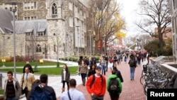 FILE - College students walk through campus in Philadelphia, Pennsylvania, Dec. 1, 2016. About a quarter of students at 66 tertiary institutions in the United States said they had gone hungry in the previous month, according to a survey.