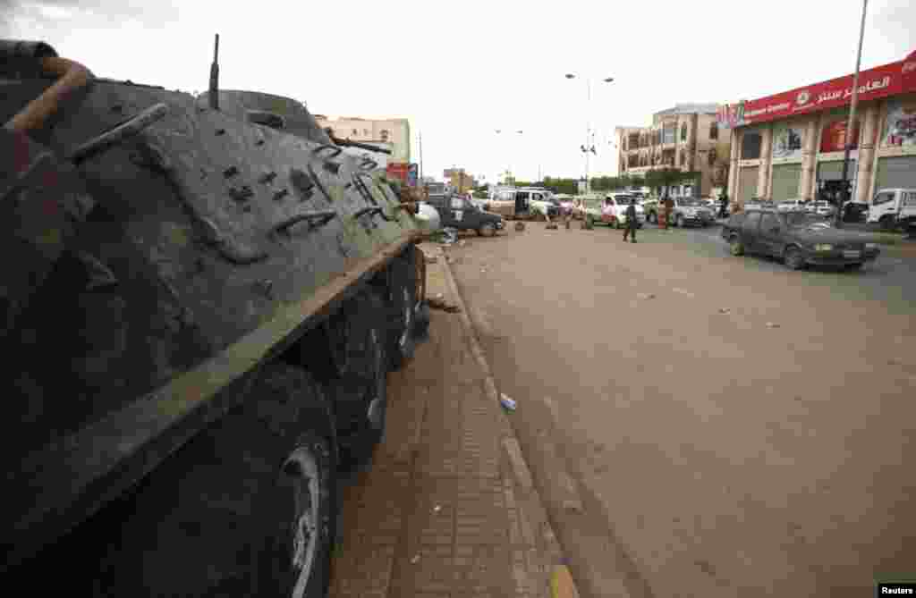 A police armoured personnel carrier is stationed at a checkpoint on the road leading to the Sanaa International Airport August 6, 2013.