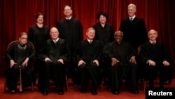File -- U.S. Supreme Court justices, front row, from left, Ruth Bader Ginsburg, Anthony Kennedy, Chief Justice John Roberts, Clarence Thomas and Stephen Breyer; back row, from left, Elena Kagan, Samuel Alito, Sonia Sotomayor and Associate Justice Neil Gorsuch. (REUTERS/Jonathan Ernst)