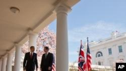 Britaniya Bosh vaziri Deyvid Kameron Oq uyda prezident Barak Obama bilan matbuot anjumanidan keyin, 14-mart, 2012-yil, Vashington
