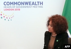 FILE - South African Minister of International Relations and Co-operation, Lindiwe Sisulu, listens during bilateral talks with Britain in central London, April 17, 2018.